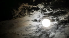 Moon bright beautiful clouds passing- timelspse Stock Footage