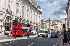 London -august 4:typical double decker buses in the picadilly st on august 4, Stock Photos