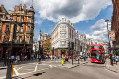 london -august 4:typical double decker buses in shaftesbury ave on august 4,  - stock photo