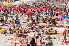 Beach Crowded With People Stock Photos