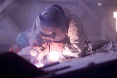 Welder working in a copper mine Stock Photos