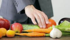Man choosing vegetables, healthy food, vegetables and fruits on the table - stock footage