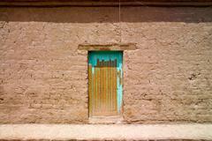 old door at an adobe house, san pedro de atacama, chile - stock photo