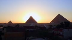 Sunrise behind the great pyramids of Giza. Stock Footage