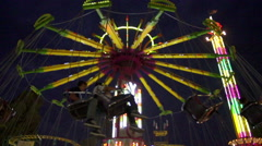 Wide Shot of the Swing Ride at the County Fair at 240 fps Stock Footage