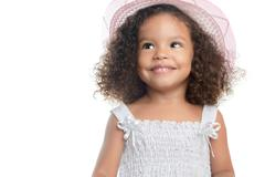 Small afro american girl wearing a pink hat Stock Photos