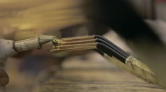 Worker tests electrical current in armature Stock Footage