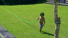 Mother and son having fun in the garden, slow motion Stock Footage