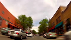 Riding In Downtown Flagstaff Bike Lane Fast Motion - stock footage