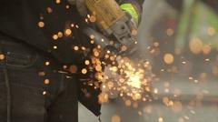 Worker Grinding Steel Tracks ��� Slow Motion Stock Footage