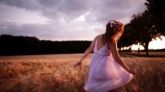 Girl Running Through Wheat Field Stock Footage