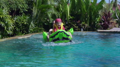 Mother playing with son in the pool, slow motion shot Stock Footage