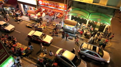 Time lapse of pedestrians and traffic in busy Chinatown street scene Stock Footage