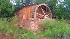 Old Fashioned Water Wheel And Wooden Shed Stock Footage