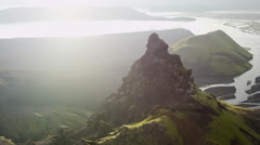 Stock Video Footage of Aerial Sun Flare Mountain Meltwater Natural Lakes Pinnacles Iceland