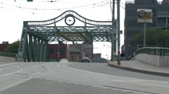 A Streetcar Drives  Across a Bridge in Downtown Toronto Stock Footage