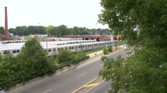 Subway train drives on tracks, parallel to highway Stock Footage