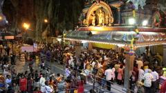 Devotees worship inside Batu Caves temple - stock footage
