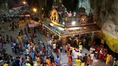 Time lapse - Devotees worship inside Batu Caves temple - stock footage