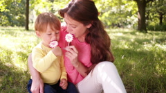 Mother and Son Enjoys Matching Lollipops Stock Footage