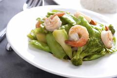 Stir fried snow peas with shrimp. - stock photo