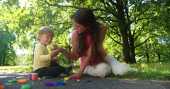 Woman and Toddler Using Play Dough Stock Footage