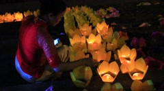 Girls light candles in traditional festival,Asia Stock Footage