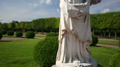 Stock Video Footage of Pan view of one of the Peterhof's statues.