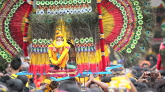Devotees dancing with Kavadi in crowd at Thaipusam festival Stock Footage