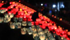 Girls light candles in traditional festival, Asia Stock Footage