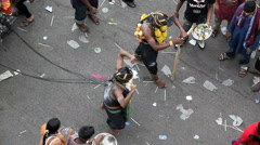 Entranced devotees with hooks piercing their backs at Thaipusam Festival - stock footage