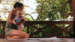 Mother and baby are doing physical exercises Stock Footage