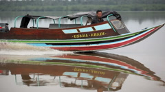 Man in wooden speed boat travels on river Stock Footage
