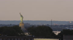 Statue of Liberty subway train elevated track sunset 4K New York City NYC Stock Footage