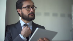 Head and Shoulders of Businessman with Digital Tab - stock footage