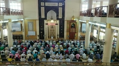 Time lapse of crowds of muslim men listening to the khutbah or preaching - stock footage