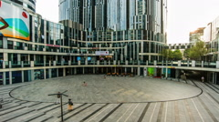 People take a rest at the square of Sanlitun soho shopping center in Beijing - stock footage
