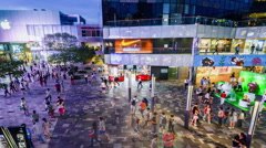 Fashion young people wander the Sanlitun Village shopping center in Beijing - stock footage