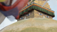 Eyes of boudhanath and prayer flags Stock Footage