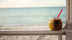 Coconut Drink on the Beach Stock Footage