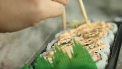 Close up of chop sticks and sushi Stock Footage