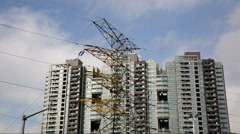 China apartments with high voltage cables and clouds timelapse Stock Footage