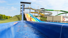Slide splash aqua park amusement water park Stock Footage