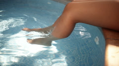 Woman Legs At Poolside - stock footage