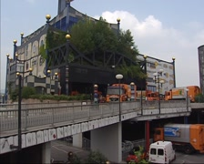 Garbage trucks - tilt up exterior District Heating Plant Spittelau, Vienna Stock Footage