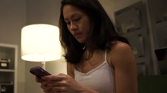 Asian woman texting close up Stock Footage