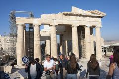 people sightseeing temple of athena nike in athens - stock photo