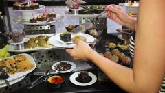 Person Chooses Sweet Meal in Buffet - stock footage