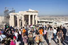 tourists sightseeing temple of athena nike in athens - stock photo