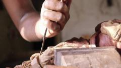 7of9 Black sculptor, artist, art, wooden statue, hands, tool - stock footage